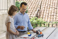 Father teaching his daughter electronics and robotics - ALBF00927