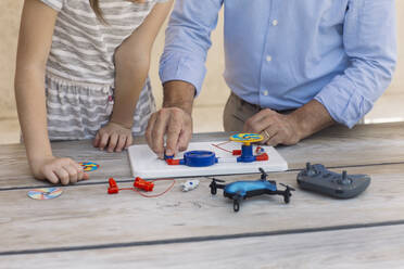Father teaching his daughter electronics and robotics - ALBF00930
