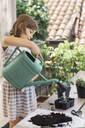 Girl repotting plant - ALBF00939