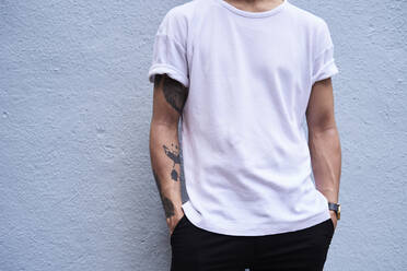Young man with tattooed arm, partial view - IGGF01200