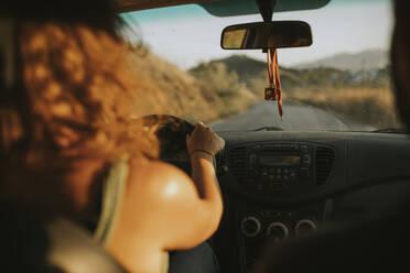 Woman driving a car, rear view - DMGF00069
