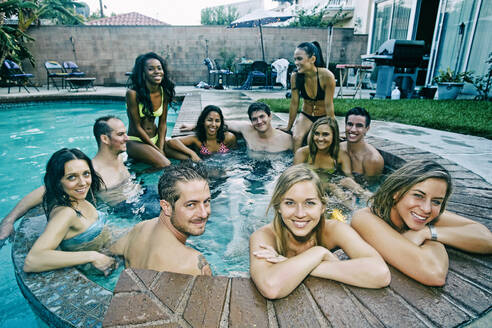 Friends relaxing in hot tub - BLEF08268