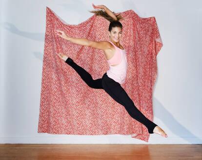 Mixed race dancer practicing in studio - BLEF08520