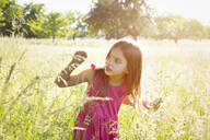 Portrait of little girl standing in summer meadow - LVF08132