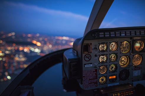 Close up of control panel of airplane flying at night - BLEF08891