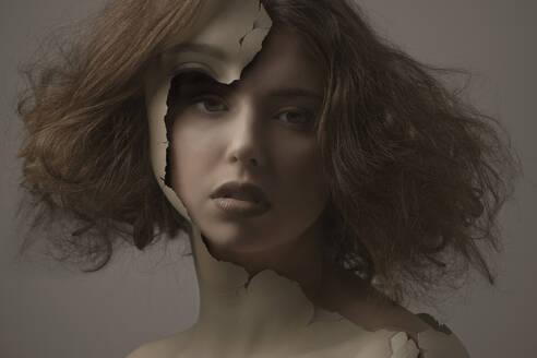 Caucasian woman with broken plastic skin - BLEF08971