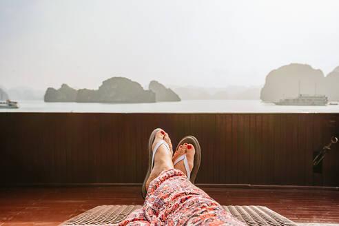 Caucasian woman on boat in Ha Long Bay, Vietnam - BLEF09022