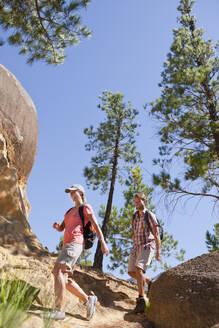 Couple hiking on rural hillside - JUIF02276