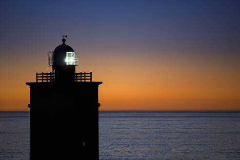 Scenic view of lighthouse at sunset - JUIF02345