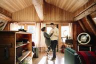 Affectionate couple dancing in cabin - HEROF37240