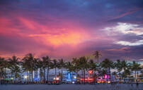Beachfront buildings under sunset sky - BLEF09354