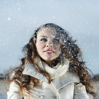 Caucasian woman playing in snow - BLEF09476