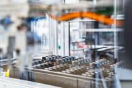 Intricate machinery inside modern factory, Stuttgart, Germany - DIGF07173