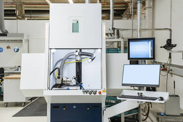 Control station of laser marking system inside modern factory, Stuttgart, Germany - DIGF07194
