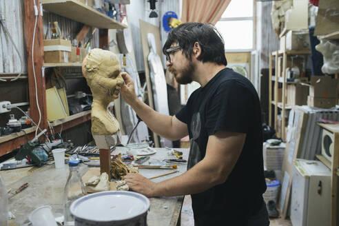 Russia, Blagoveschensk, sculptor, man, master, workplace, workshop - VPIF01300