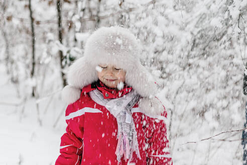 Portrait of a girl standing in a wintry forest - OGF00020