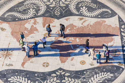 Portugal, Lisbon, Belem, High angle view of people standing on map mosaic - WD05313