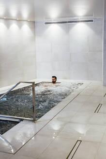 Man in a whirlpool in a spa - LJF00392