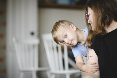 Portrait of little boy on his mother's arms at home - EYAF00291