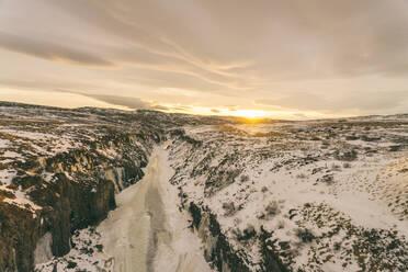 Iceland, Frozen river near Krafla region before sunset - TAMF01748
