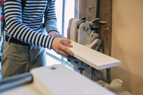 Carpenter working on a grinder - VPIF01333