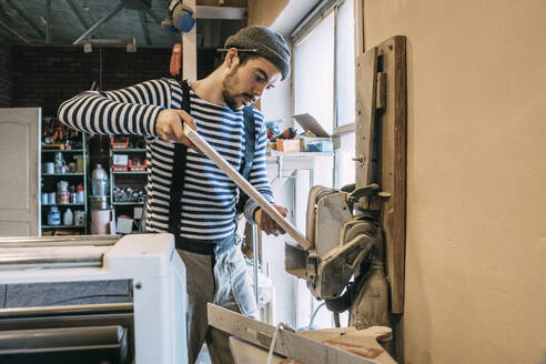 Carpenter at work on a grinder - VPIF01336