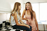 Native American mother and daughter talking in kitchen - BLEF09514