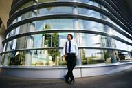 Black businessman smiling outside office building - BLEF09610