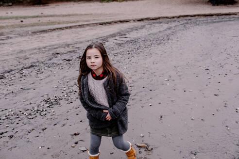 Portrait of little girl at riverside in autumn - OGF00045