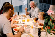High angle view of multi-generation family having food at table in restaurant - MASF13108