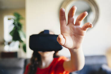 Mixed race girl using virtual reality goggles - BLEF09831