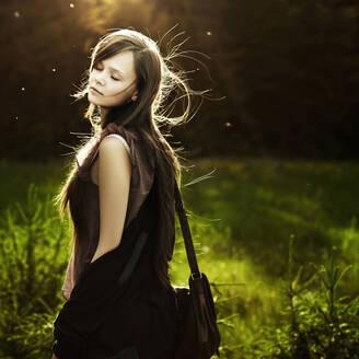 Caucasian woman walking in field - BLEF09844