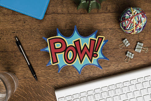View from above POW sign on wooden desk - FSIF04091