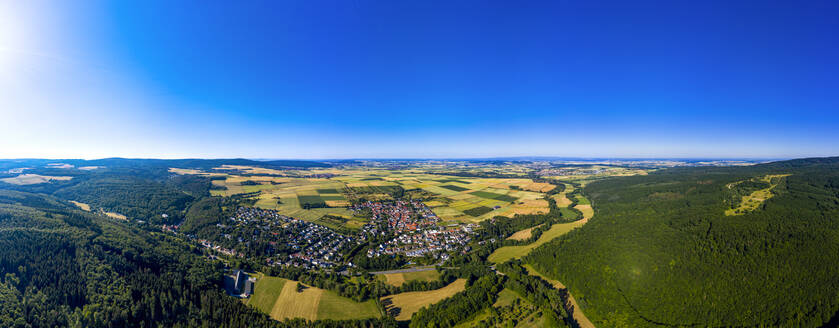 Aerial view over grain fields, meadows, woods and villages, Wetterau, Germany - AMF07201