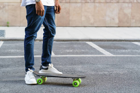 Legs of young man with skateboard - MGIF00574