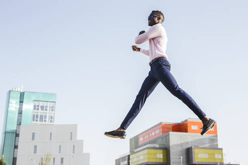Young businessman jumping mid-air - LJF00464