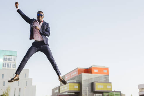 Young businessman jumping mid-air - LJF00467