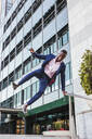Young businessman jumping mid-air - LJF00482