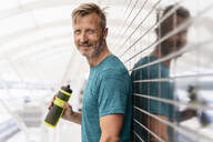 Portrait of sporty man taking a break after workout - DIGF07516