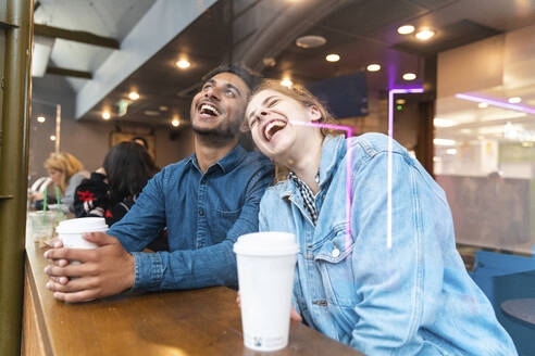 Friends having fun together in a coffee shop - WPEF01615