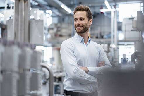 Portrait of a confident businessman in a modern factory - DIGF07567