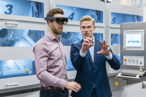 Two businessmen with AR glasses in a modern factory - DIGF07627