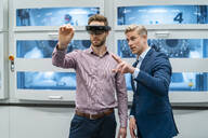 Two businessmen with AR glasses in a modern factory - DIGF07693
