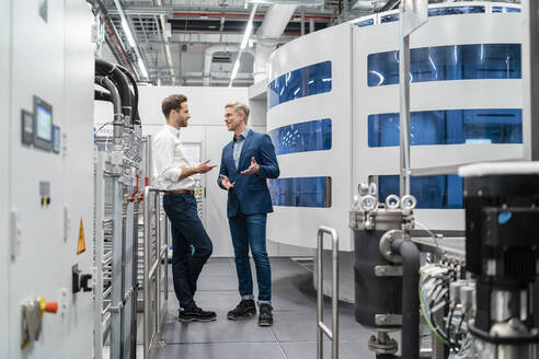 Two businessmen talking in a modern factory - DIGF07708