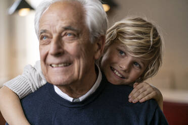 Happy grandson hugging grandfather - GUSF02271