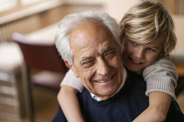 Happy grandson hugging grandfather - GUSF02274