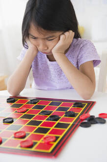 Frustrated Vietnamese playing checkers game - BLEF10325