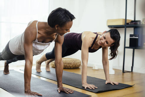 Two women doing gymnastics at home - SODF00011