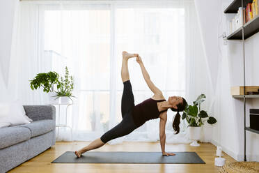 Woman practicing yoga at home - SODF00020
