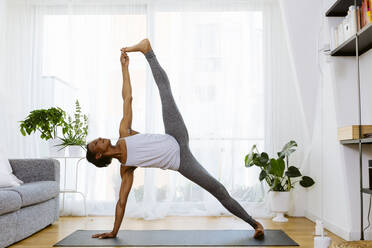Woman practicing yoga at home - SODF00023